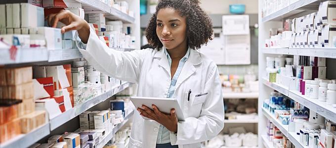 pharmacist checking stock of medicine