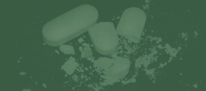 Abstract art showing two pills, with one being cracked open